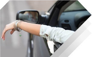 women driving relaxed with comprehensive and collision insurance coverage