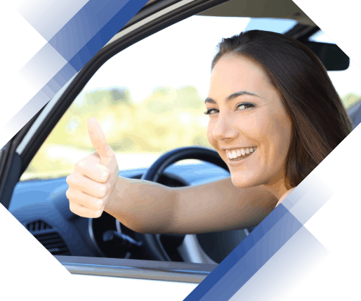 Cheerful woman driving her car